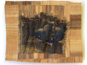 "Dorothy Clews, ""The Space Between""  Raffia and antique tapestry fragment both stitched and woven into raffia backing"