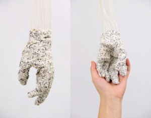 "Sabrina Niebler, ""Rooted in the Hand""; 6"" x 3.5"" x 2.5""; 2013; rice paper (silk screened with text and hand spun into yarn) and cotton warp, pulled warp and pieced tapestry"